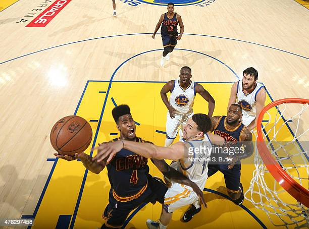 Iman Shumpert of the Cleveland Cavaliers goes up to shoot against Klay Thompson of the Golden State Warriors during Game Two of the 2015 NBA Finals...