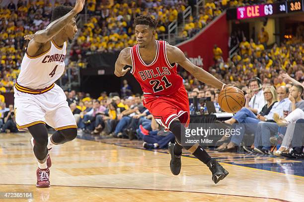 Iman Shumpert of the Cleveland Cavaliers guards Jimmy Butler of the Chicago Bulls in the second half during Game One in the Eastern Conference...