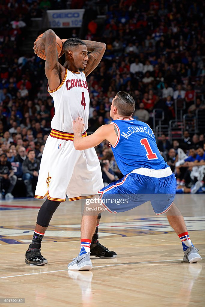 Iman Shumpert #4 of the Cleveland Cavaliers looks to pass the ball while guarded by T.J. McConnell #1 of the Philadelphia 76ers at the Wells Fargo Center on November 5, 2016 in Philadelphia, Pennsylvania.