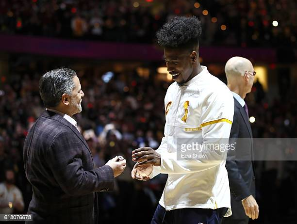 Iman Shumpert of the Cleveland Cavaliers receives his championship ring from owner Dan Gilbert before the game against the New York Knicks at Quicken...