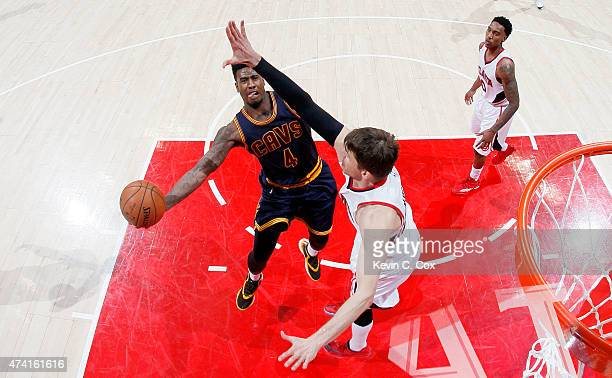 Iman Shumpert of the Cleveland Cavaliers shoots against Kyle Korver of the Atlanta Hawks in the second half during Game One of the Eastern Conference...