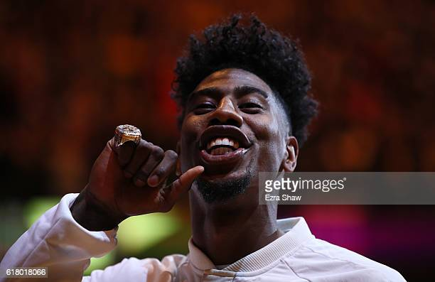 Iman Shumpert of the Cleveland Cavaliers shows his championship ring before the game against the New York Knicks at Quicken Loans Arena on October 25...