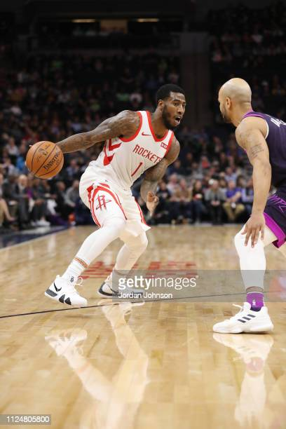 Iman Shumpert of the Houston Rockets handles the ball against the Minnesota Timberwolves on February 13 2019 at Target Center in Minneapolis...
