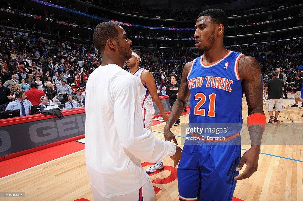 Iman Shumpert #21 of the New York Knicks and Chris Paul #3 of the Los Angeles Clippers shke hands after a game against the Losa Angeles Clippers at Staples Center on November 27, 2013 in Los Angeles, California.