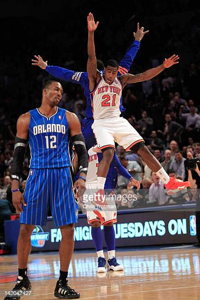 Iman Shumpert of the New York Knicks and JR Smith of the New York Knicks chest bump after a Shumpert three pointer as Dwight Howard of the Orlando...