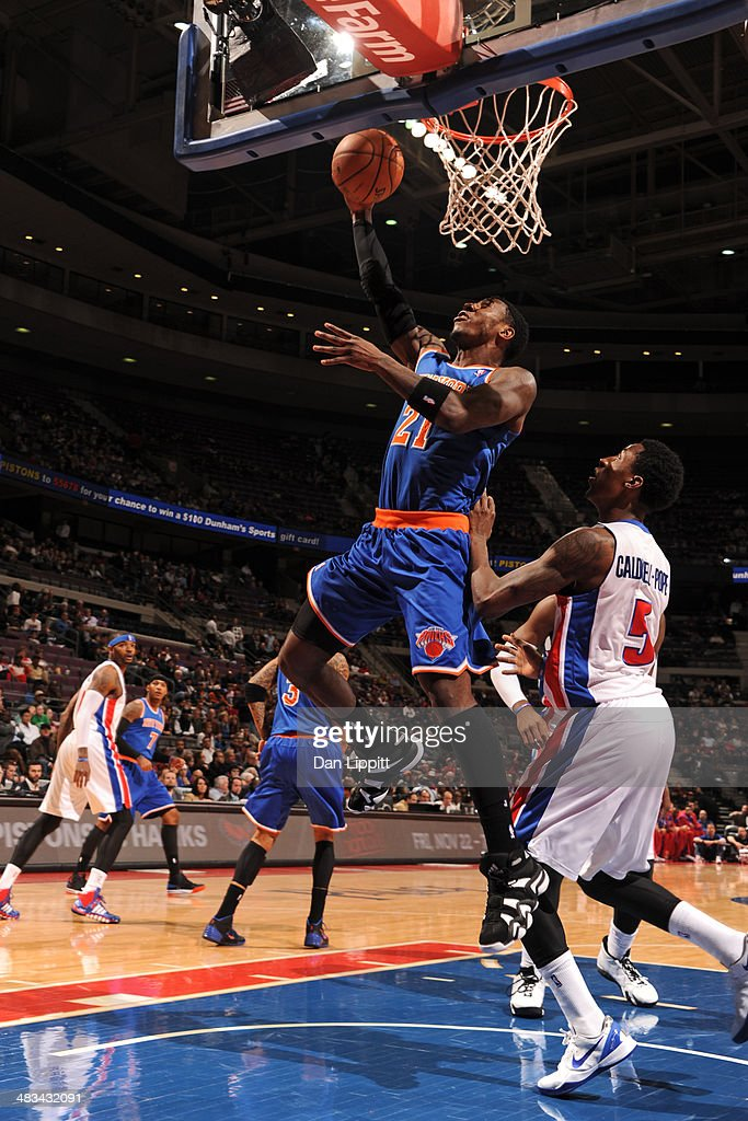 Iman Shumpert #21 of the New York Knicks drives to the basket during the game against the Detroit Pistons on November 19, 2013 at The Palace of Auburn Hills in Auburn Hills, Michigan.