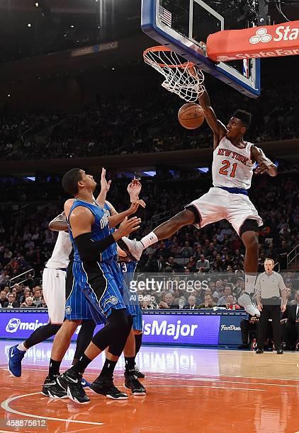 Iman Shumpert of the New York Knicks dunks against the Orlando Magic during their game at Madison Square Garden on November 12 2014 in New York City