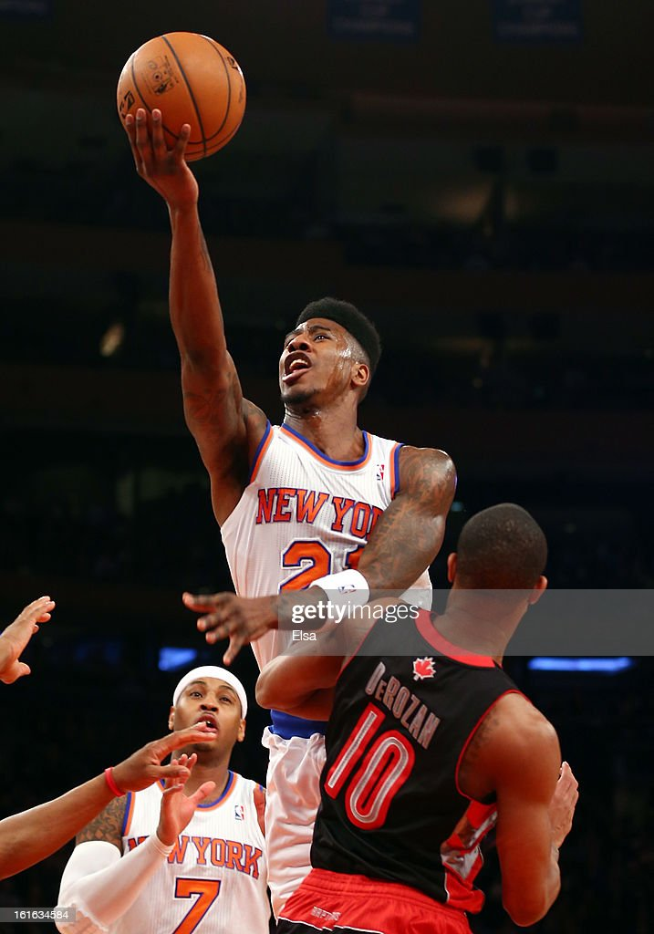 Iman Shumpert #21 of the New York Knicks heads for the net as DeMar DeRozan #10 of the Toronto Raptors defends on February 13, 2013 at Madison Square Garden in New York City.