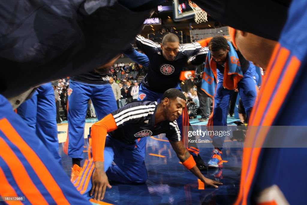Iman Shumpert #21 of the New York Knicks pumps his team up before the game against the Charlotte Bobcats at the Time Warner Cable Arena on November 8, 2013 in Charlotte, North Carolina.