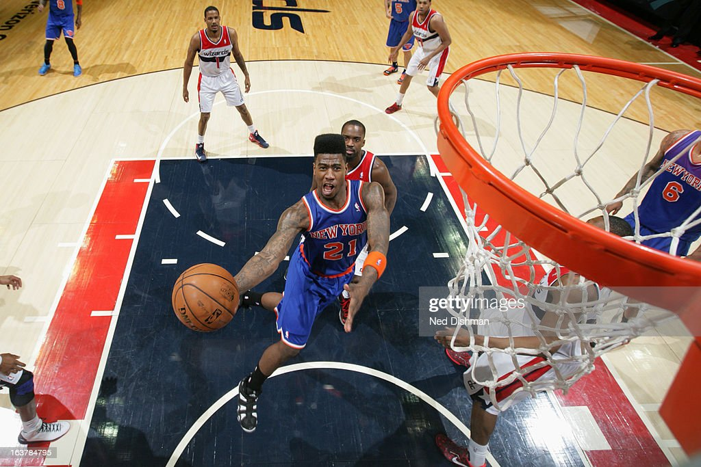 Iman Shumpert #21 of the New York Knicks shoots a layup against the Washington Wizards at the Verizon Center on March 1, 2013 in Washington, DC.