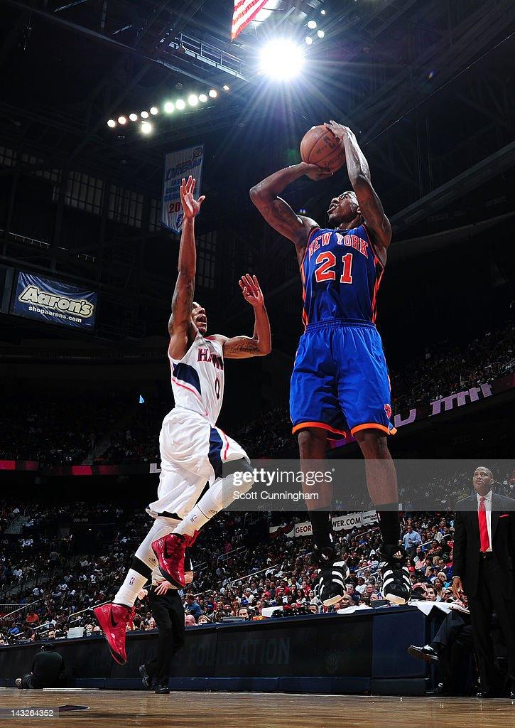 Iman Shumpert #21 of the New York Knicks shoots against Jeff Teague #0 of the Atlanta Hawks on April 22, 2012 at Philips Arena in Atlanta, Georgia.