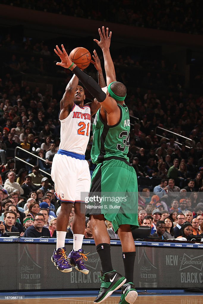 Iman Shumpert #21 of the New York Knicks shoots the ball against Paul Pierce #34 of the Boston Celtics on March 31, 2013 at Madison Square Garden in New York City.