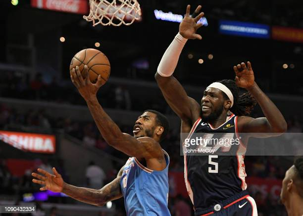 Iman Shumpert of the Sacramento Kings gets past Montrezl Harrell of the Los Angeles Clippers in the second half at Staples Center on January 27 2019...