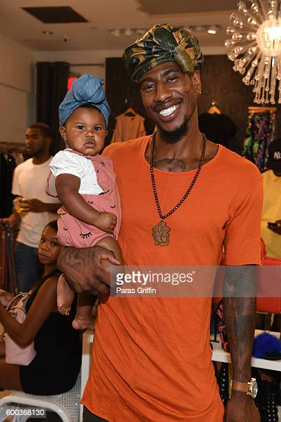 Iman Shumpert with his daughter Iman Tayla Junie Shumpert Jr Baby Buddha Bug Collection Hosted By Teyana Taylor Iman Shumpert at Pressed on September...
