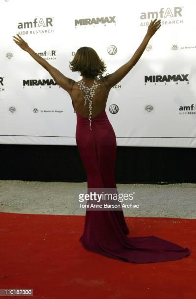 Iman wearing a DeBeers diamond necklace during 2003 Cannes Film Festival Cinema Against Aids 2003 to benefit amfAR sponsored by Miramax Arrivals at...