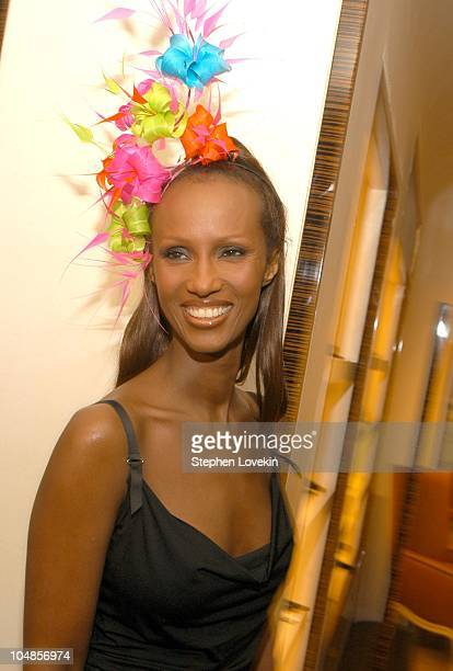 Iman wearing a Philip Treacy hat during Philip Treacy Shows His Spring 2003 Hat Collection at Bergdorf's at Bergdorf Goodman in New York City, NY,...
