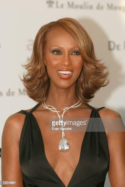 Iman wearing the De Beers Millennium Star 203 carat diamond necklace arriving at amfAr's Cinema against AIDS 2002 benefit gala at Le Moulin de...