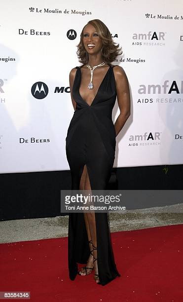 Iman wears the De Beers Millennium Star necklace with the world's largest flawless pear shaped diamond weighing 203 carats It is suspended from a...