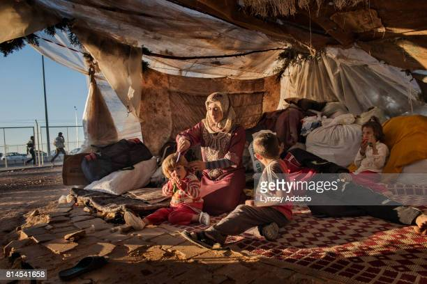 CAMP ONCUPINAR TURKEY OCTOBER 22 2013 Iman Zenglo sat with her five children in their tent at a squatters camp outside of the Kilis refugee camp on...