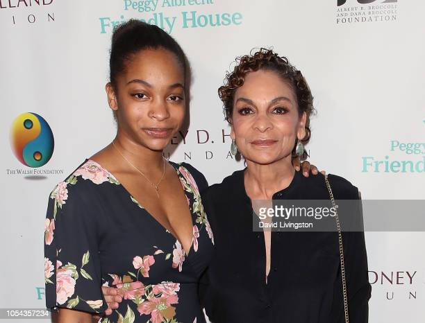 Imani Duckett and Jasmine Guy attend the Peggy Albrecht Friendly House's 29th Annual Awards Luncheon at The Beverly Hilton Hotel on October 27 2018...