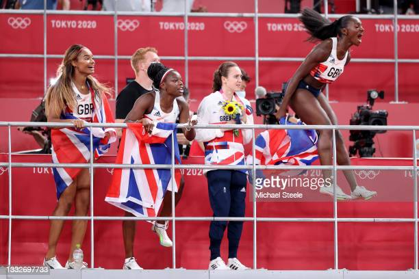 Imani Lansiquot, Asha Philip, Laura Muir and Dina Asher-Smith of Team Great Britain show their support for Team Great Britain in the Men's 4 x 100m...