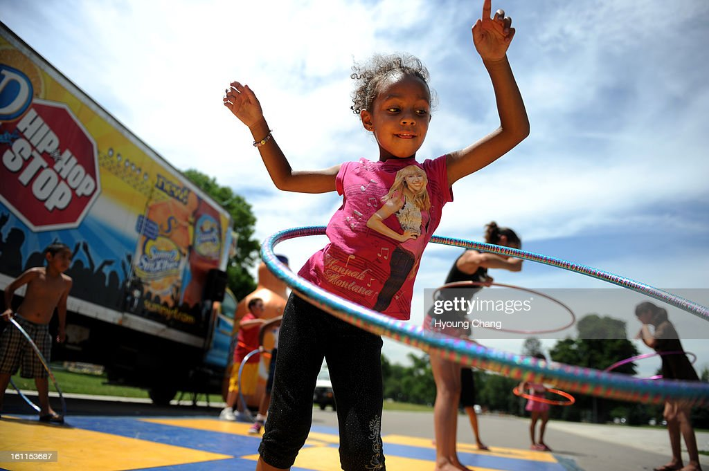 (JS)Imani Mills, 5, of Denver is Hula Hooping during Denver Black Art Festival at City Park on Friday. Hyoung Chang/ The Denver Post : News Photo