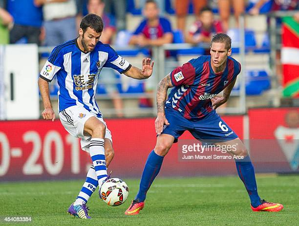Imanol Agirretxe of Real Sociedad duels for the ball with Raul Albentosa of SD Eibar during the La Liga match between SD Eibar and Real Sociedad at...