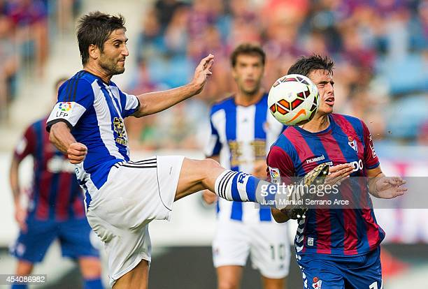 Imanol Agirretxe of Real Sociedad duels for the ball with Raul Rodriguez of SD Eibar during the La Liga match between SD Eibar and Real Sociedad at...