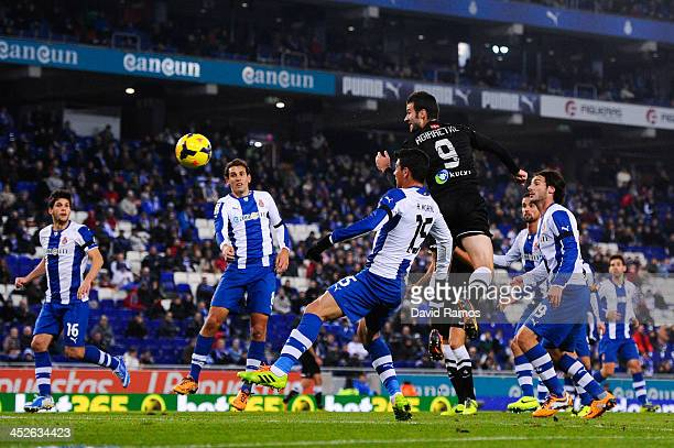 Imanol Agirretxe of Real Sociedad heads the ball towards goal among RCD Espanyol players during the La Liga match between RCD Espanyol and Real...