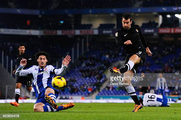 Imanol Agirretxe of Real Sociedad shoots towards goal under a challenge by Diego Colotto of RCD Espanyol during the La Liga match between RCD...