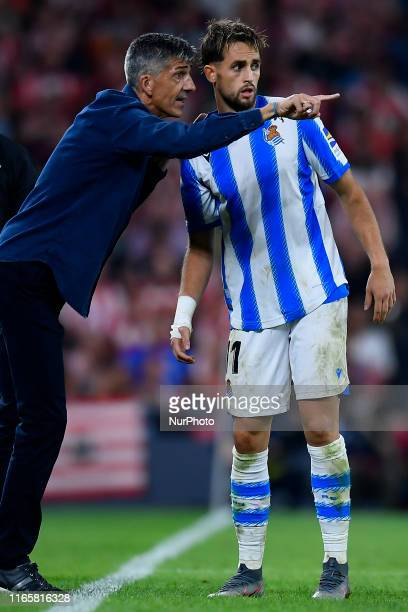 Imanol Alguacil head coach of Real Sociedad gives instructions to Adnan Januzaj during the Liga match between Athletic Club and Real Sociedad at San...