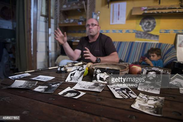 Imanol Arteaga nephew of Spanish missionary Luis Cuartero gestures during an interview in Ricla near Zaragoza on November 7 surrounded by photos...