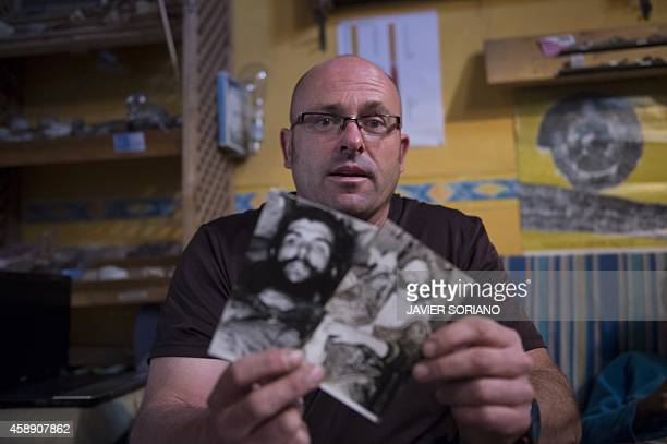 Imanol Arteaga nephew of Spanish missionary Luis Cuartero shows photos taken on October 10 1967 by former AFP journalist Marc Hutten showing the...