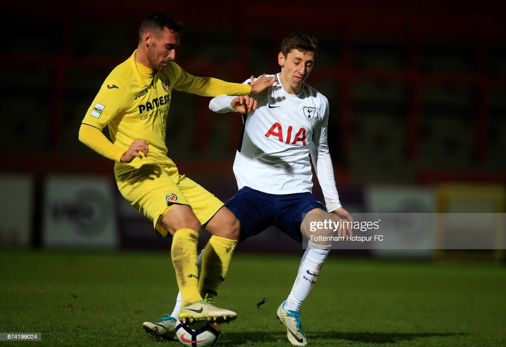 Imanol Garcia of Villarreal is tackled by Jack Roles of Tottenham during the Premier League International Cup match between Tottenham Hotspur and Villarreal at The Lamex Stadium on November 14, 2017 in Stevenage, England.