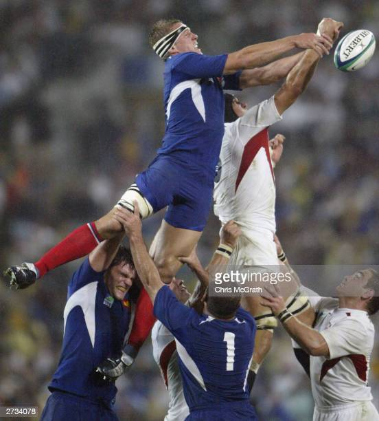 Imanol Harinordoquy of France hits the ball out from a lineout during the Rugby World Cup Semi-Final match between England and France at Telstra...