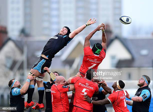 Imanol Harinordoquy of Toulouse and Tim Swinson of Glasgow Warriors challenge at a line out during the European Rugby Champions Cup Pool 4 match...