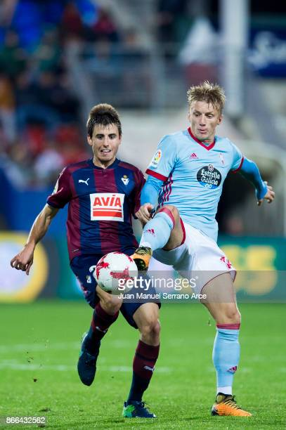 Imanol Sarriegui of SD Eibar duels for the ball with Daniel Wass of RC Celta de Vigo during the Copa Del Rey match between Eibar and RC Celta de Vigo...