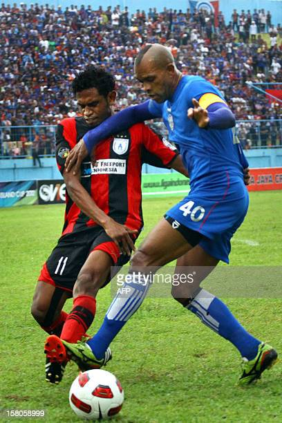Imanuel Wanggai of Persipura Jayapura and Keith Kayamba of Arema Indonesia duels for the ball in a game that ended in a tie score 11 at the Inter...