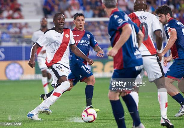 Imbula midfielder of Rayo Vallecano de Madrid competes for the ball during the La Liga game between SD Huesca and Rayo Vallecano de Madrid at Estadio...