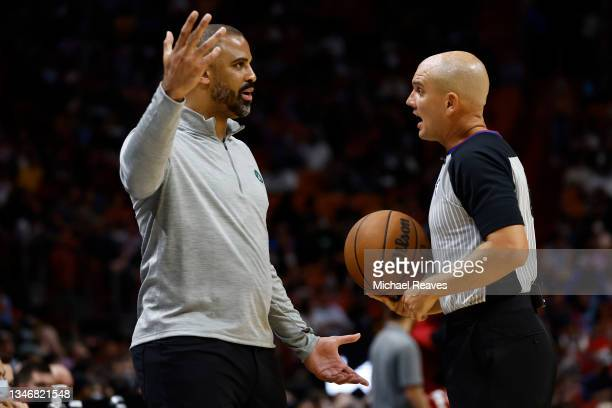 Ime Udoka of the Boston Celtics argues with referee Jacyn Goble against the Miami Heat during the second half of a preseason game at FTX Arena on...