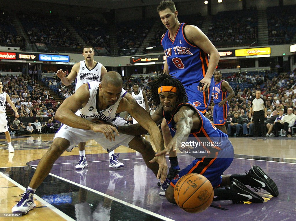 Ime Udoka #3 of the Sacramento Kings fights for the ball with Jordan Hill #43 of the New York Knicks on November 25, 2009 at ARCO Arena in Sacramento, California. (Photo by Jed Jacobsohn/Getty Images)