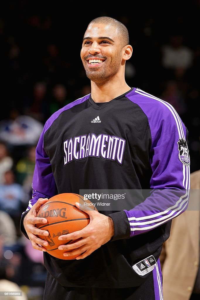 Ime Udoka #3 of the Sacramento Kings smiles before the Golden State Warriors against the Sacramento Kings during the game on February 17, 2009 at Oracle Arena in Oakland, California. The Warriors won 130-98.