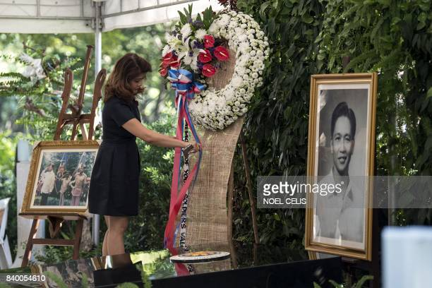 Imee Marcos daughter of former Philippine president and late dictator Ferdinand Marcos adjusts a wreath at the tomb her father on National Heroes'...