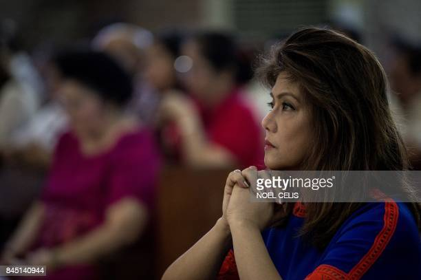 Imee Marcos daughter of former Philippine president and late dictator Ferdinand Marcos attends a mass at the Immaculate Conception Parish during...
