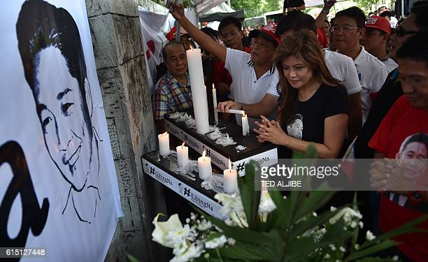 Imee Marcos daughter of the late dictator Ferdinand Marcos and governor of the family's northern stronghold of Ilocos Norte offers prayers alongside...