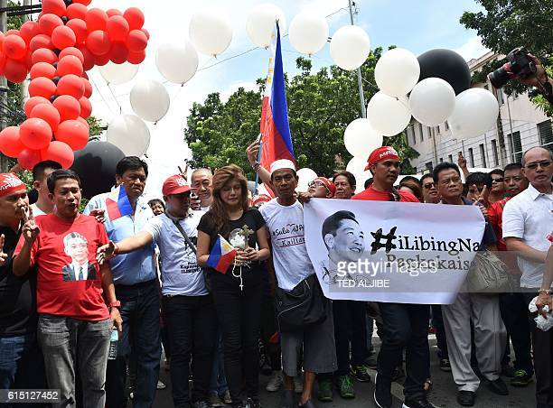 Imee Marcos daughter of the late dictator Ferdinand Marcos and governor of the family's northern stronghold of Ilocos Norte walks with supporters at...