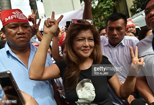 Imee Marcos daughter of the late dictator Ferdinand Marcos and governor of the family's northern stronghold of Ilocos Norte flashes the V sign at the...