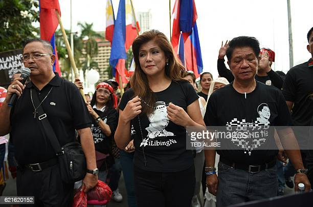 Imee Marcos daughter of the late dictator Ferdinand Marcos and governor of the family's northern stronghold of Ilocos Norte joins supporters as they...