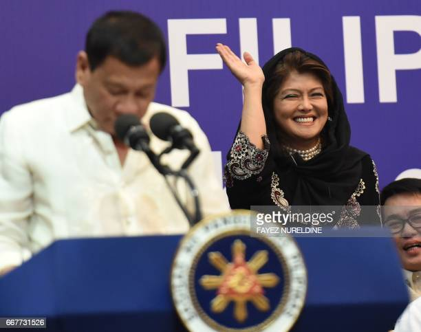 Imee Marcos daughter of the late dictator Ferdinand Marcos and governor of the family's northern stronghold of Ilocos Norte waves as Philippine...