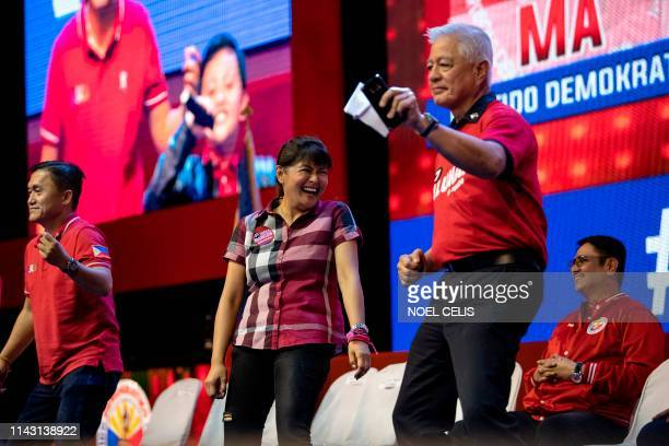 Imee Marcos daughter of the late Philippine dictator Ferdinand Marcos dances with other senatorial candidates of the Partido Demokratiko...